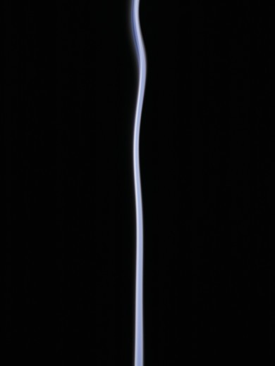Stock Photo: 4306R-12209 Smoke towards black background.