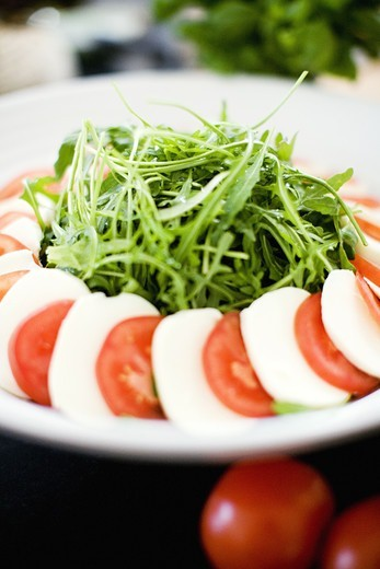Stock Photo: 4306R-12335 Rucola, tomatoes and mozzarella on a plate, Sweden.