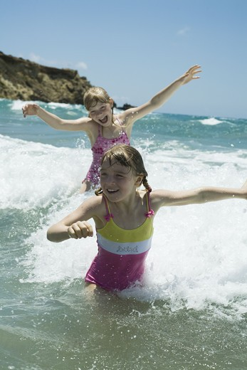 Stock Photo: 4306R-12916 Two scandinavian girls bathing in the sea, Greece.