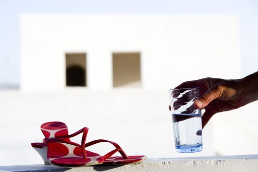 Glass of water and shoes, Greece. : Stock Photo
