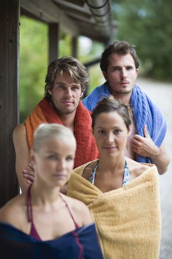 Four people with towels, Sweden. : Stock Photo