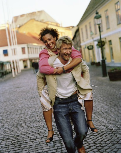 A happy couple on a cobbled street, Sweden. : Stock Photo