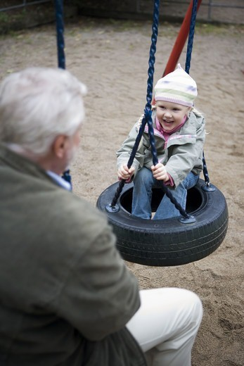 Stock Photo: 4306R-14772 Grandfather and grandchild playing together on a playground, Sweden.