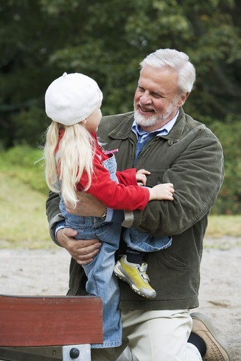 Stock Photo: 4306R-14783 Grandfather and grandchild playing together on a playground, Sweden.