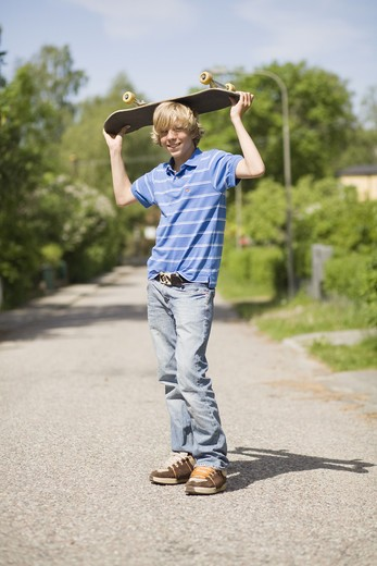 Portrait of a boy with a skateboard, Sweden. : Stock Photo