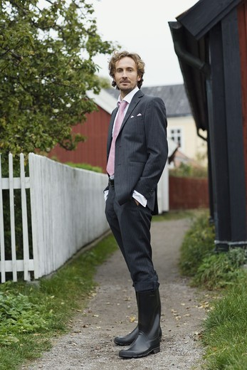 Stock Photo: 4306R-14993 A man in a suit on the countyside, Sweden.