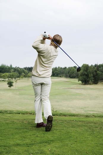 Stock Photo: 4306R-15074 A man playing golf, Sweden.