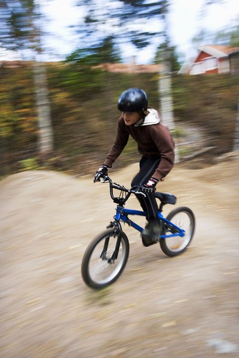 A boy on a BMX bicycle, Sweden. : Stock Photo