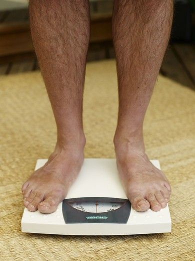 A man using a scale, Sweden. : Stock Photo