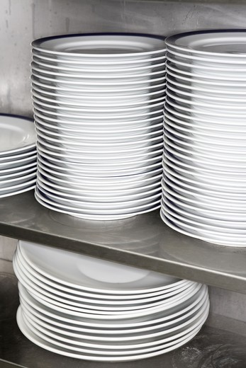 Stock Photo: 4306R-15447 Plates in a restaurant kitchen.