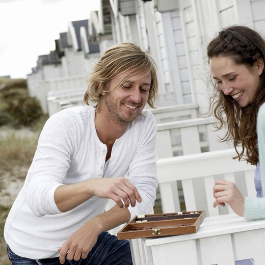 Stock Photo: 4306R-15518 A young couple playing back gammon, Skane, Sweden.
