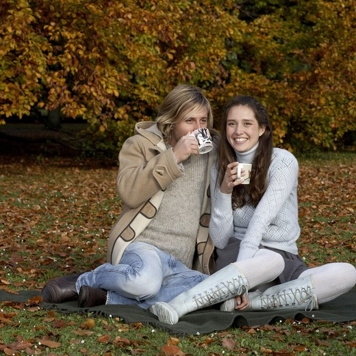 Stock Photo: 4306R-15668 A couple having a cup of coffee in a park, Skane, Sweden.
