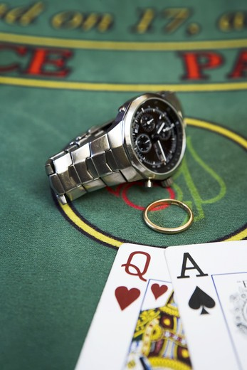Playing cards and an engagement ring at a gambling table. : Stock Photo