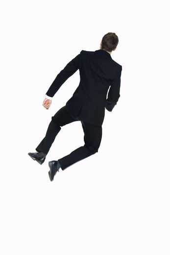 Stock Photo: 4306R-16383 A man in a suit jumping, Sweden