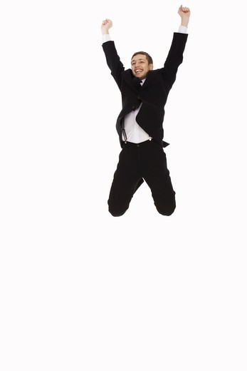 Stock Photo: 4306R-16388 A man in a suit jumping, Sweden