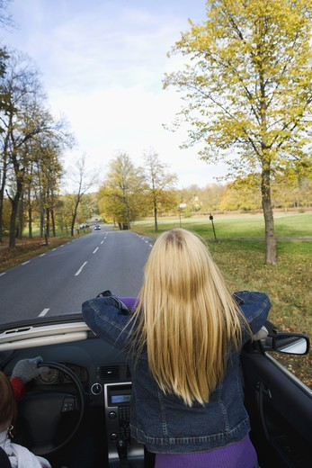 A young Scandinavian woman in a cabriolet, Sweden. : Stock Photo