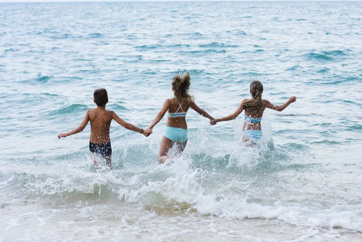 Three children on a beach, Thailand. : Stock Photo