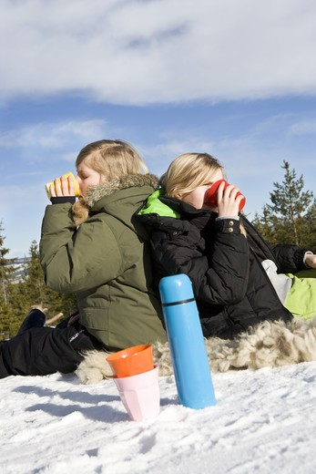Stock Photo: 4306R-17205 Two girls on ski vacation, Sweden.