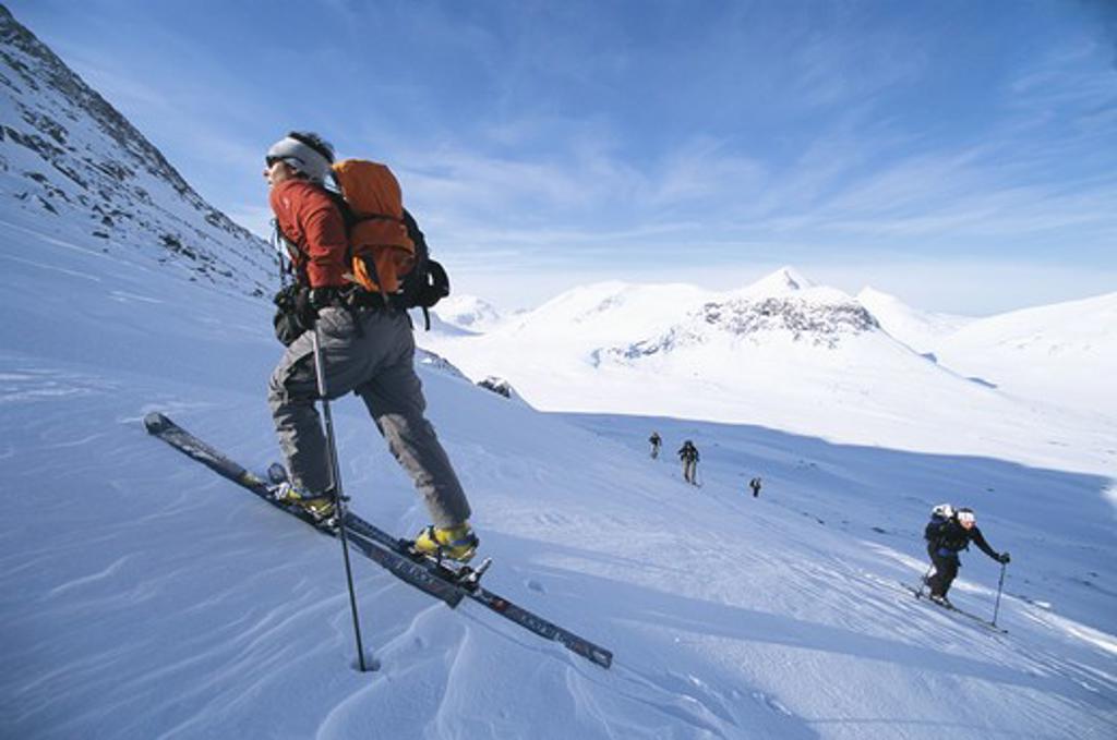 Telemark skiers in mountain scenery : Stock Photo
