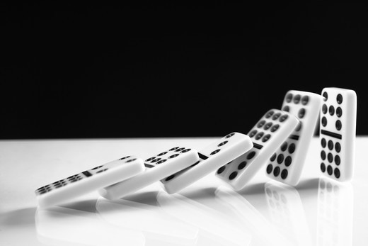 Stock Photo: 4306R-17899 Row of Domino Tiles falling.