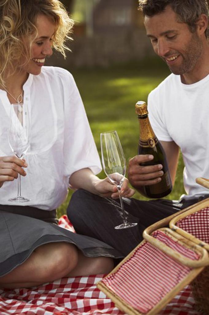 Stock Photo: 4306R-18232 Couple having champagne, Copenhagen, Denmark.