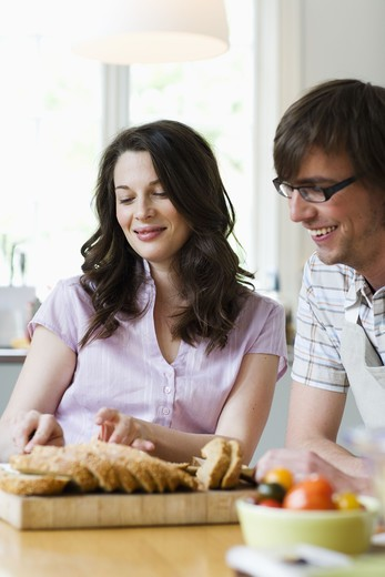 Stock Photo: 4306R-18385 A young couple in a kitchen, Sweden.