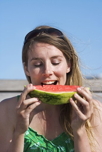 Stock Photo: 4306R-18890 A woman having a water melon, Sweden.