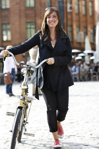 A woman with a bicycle, Malmo, Sweden. : Stock Photo