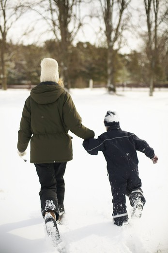 Mother and boy playing in the snow, Gotland, Sweden. : Stock Photo