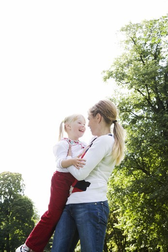 Woman and girl playing in the park, Sweden. : Stock Photo