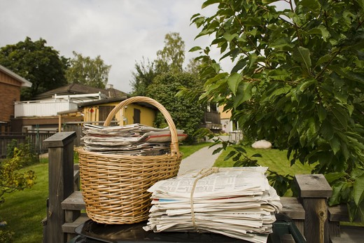 A basket full of old newspapers, Sweden. : Stock Photo