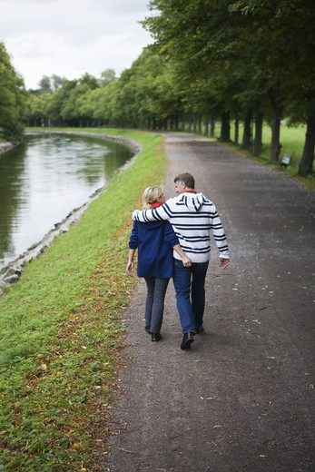 A tender couple strolling in the park, Sweden. : Stock Photo