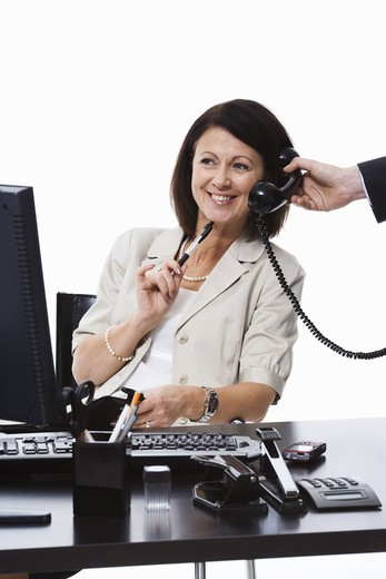Stock Photo: 4306R-20398 Businesswoman in an office.