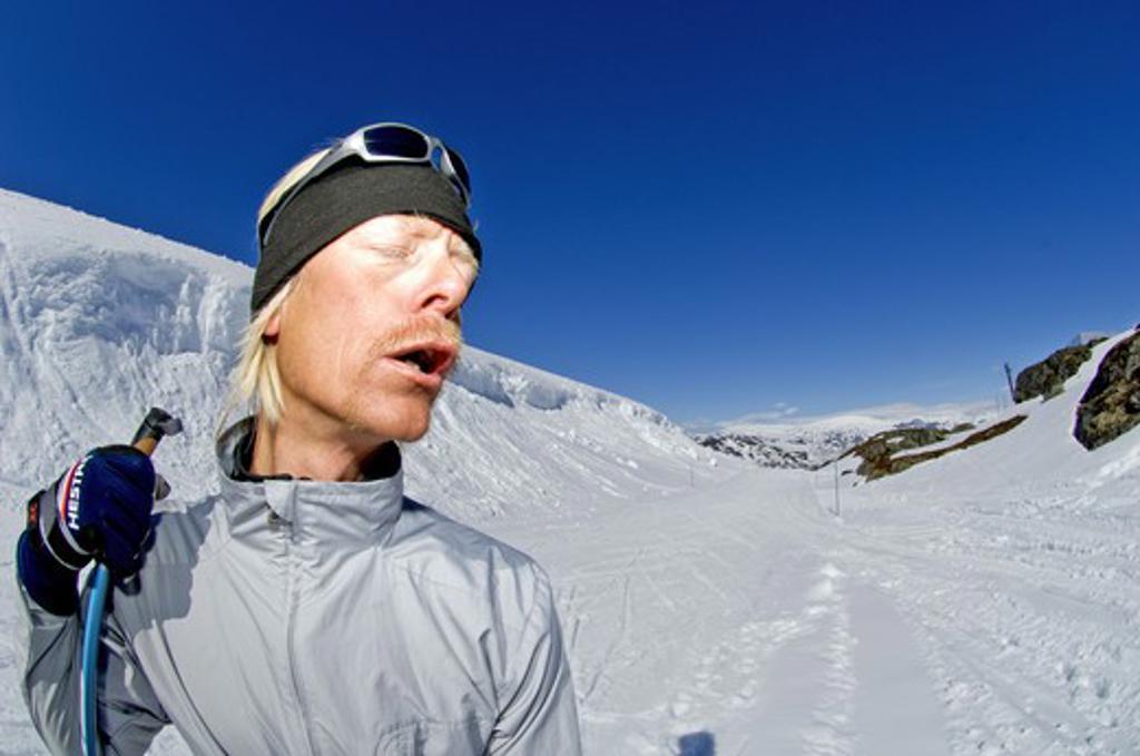 A moustached skier enjoying the sun, Riksgransen, Sweden. : Stock Photo