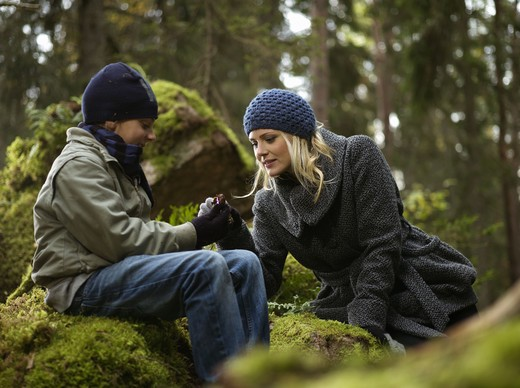 Stock Photo: 4306R-20654 Mother and son in the forest, Sweden.