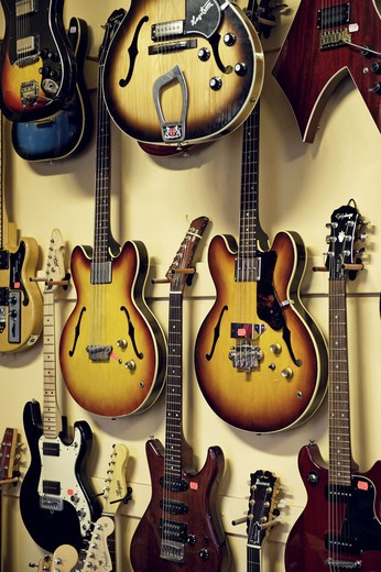 Stock Photo: 4306R-20817 Electric guitars hanging in a shop, Sweden.