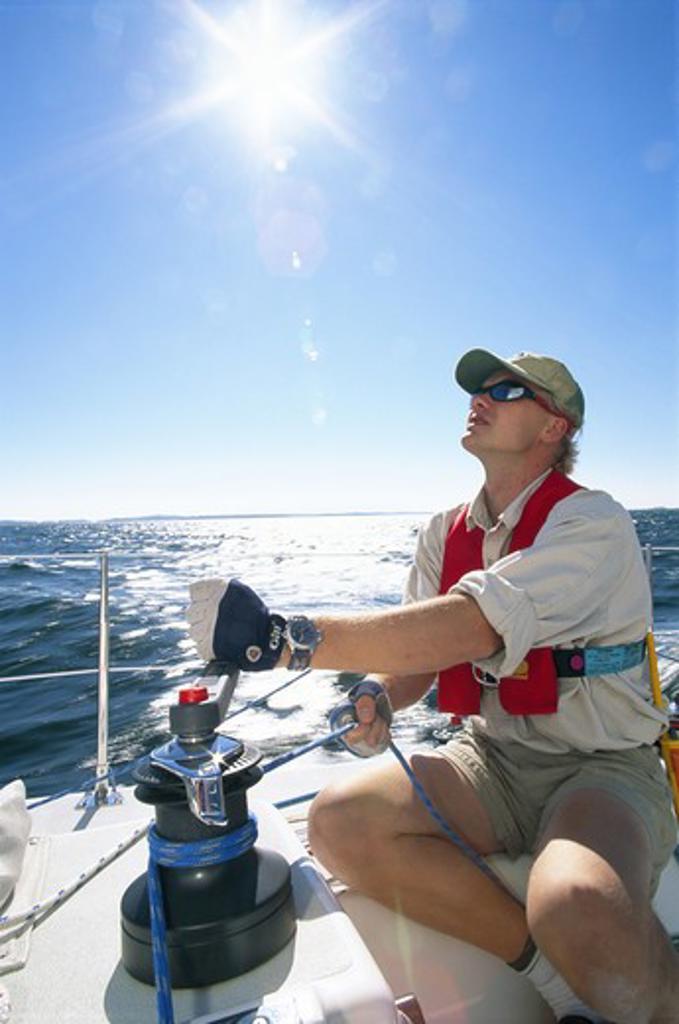 Man on a sailing-boat at sea, the Baltic Sea. : Stock Photo
