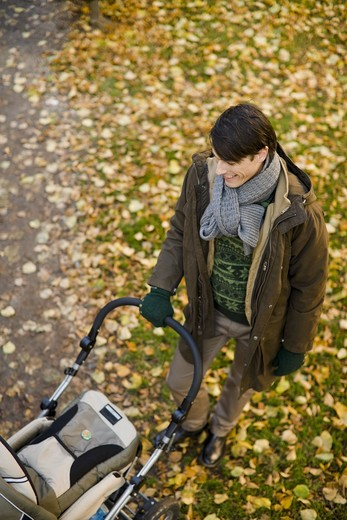 Stock Photo: 4306R-21588 Father and preambulator, Sweden.