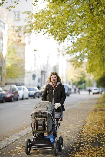 Stock Photo: 4306R-21607 Mother with preambulator, Sweden.