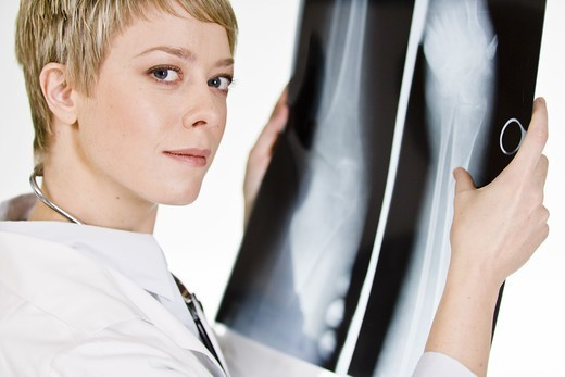Stock Photo: 4306R-21682 A female doctor holding an X-ray plate, Sweden.
