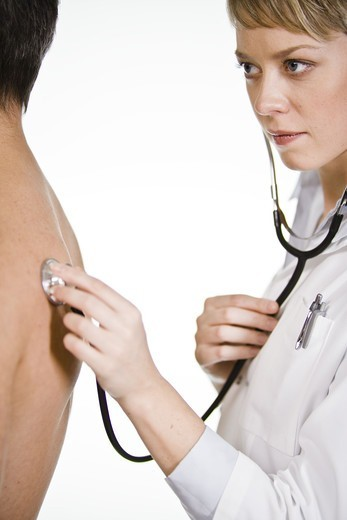 Stock Photo: 4306R-21702 Female doctor using a stethoscope at a male patient, Sweden.