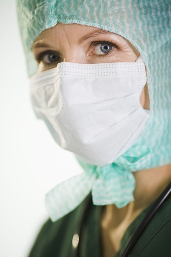 Stock Photo: 4306R-21742 A doctor wearing a green uniform.