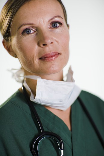Stock Photo: 4306R-21750 A doctor wearing a green uniform.