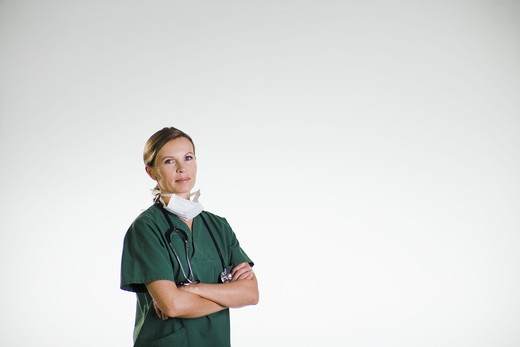 Stock Photo: 4306R-21752 A doctor wearing a green uniform.