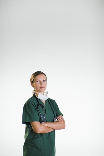A doctor wearing a green uniform. : Stock Photo