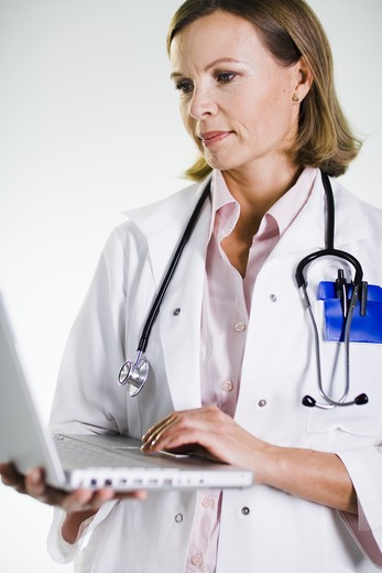 Stock Photo: 4306R-21754 A doctor using a laptop.