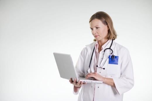 Stock Photo: 4306R-21759 A doctor using a laptop.