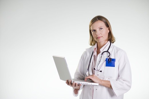 A doctor using a laptop. : Stock Photo