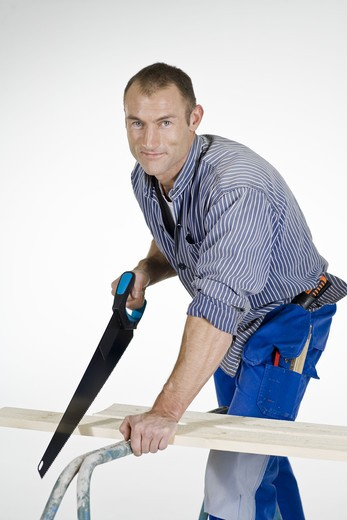Stock Photo: 4306R-22033 A joiner using a saw.
