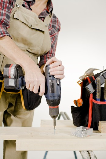 Stock Photo: 4306R-22067 A carpenter with tools.